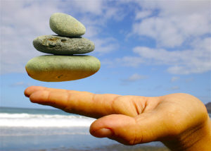 Align-Balance-Stones-balancing-above-hand-dreamstime_m_284469